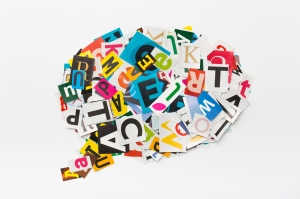 Speech bubble letters in cut out magazine.